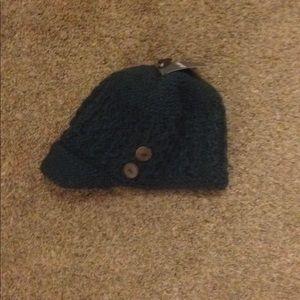 Dark green fleece lined knot newsboy cap